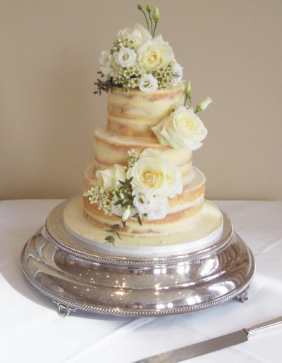 naked wedding cake white flowers keen for cakes cambridgeshire