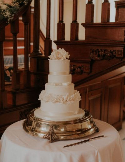 4 Tier White Wedding Cake White Roses Gossfield Hall