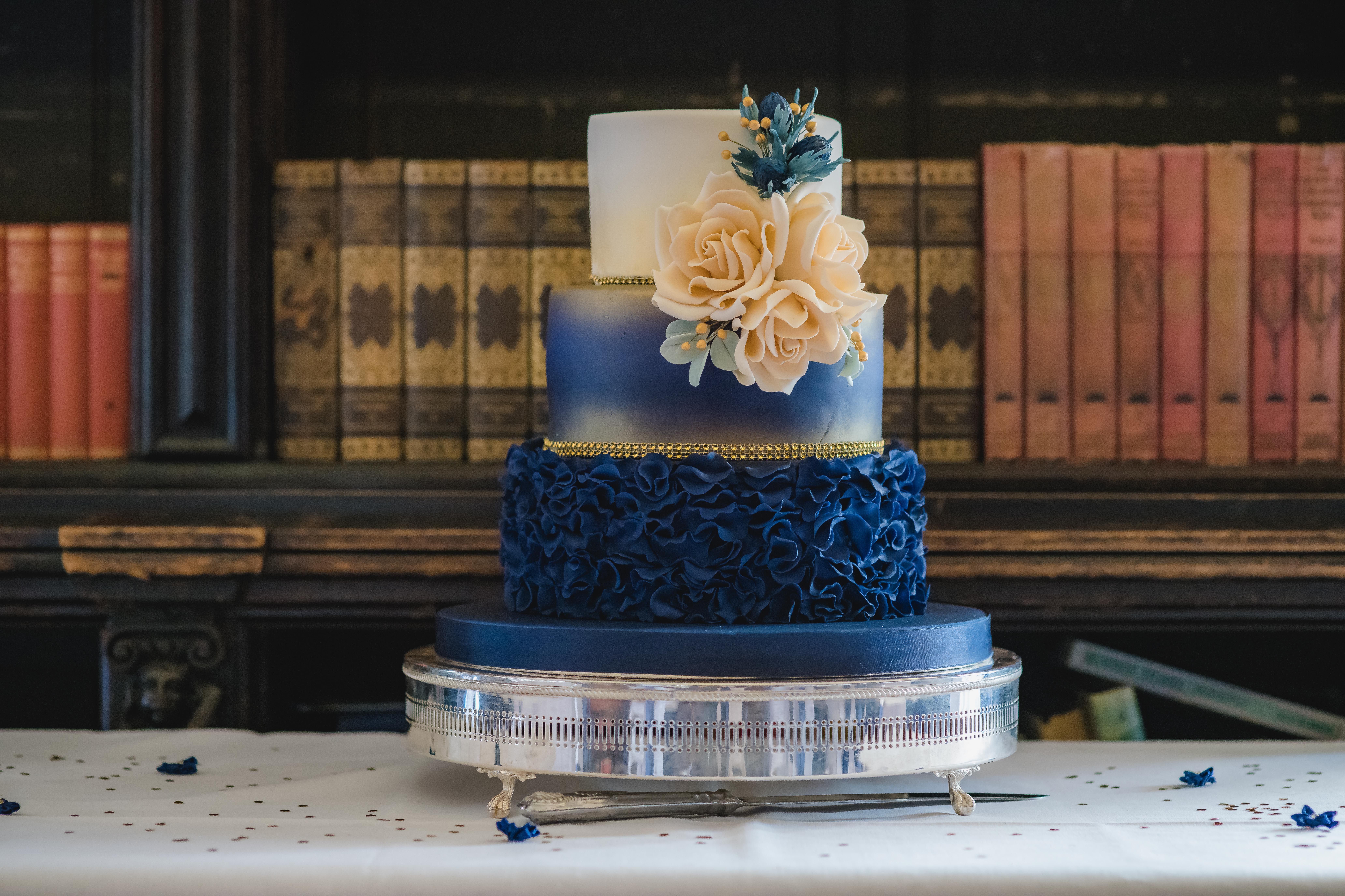 navy and gold ruffles and ombre cake